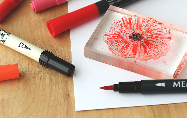 Color with markers directly on a stamp, mist lightly and you'll get a pretty poppy texture! by Lisa Spangler